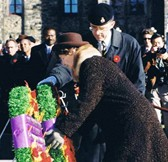 Cpl. Michael Simpson's mother, Mrs. Loyola Park, the National Silver Cross Mother, laying a wreath on behalf of the Mothers of Canada during the National Remembrance Ceremony on Parliament Hill in 1999.