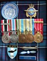 Medals and badges of Dennis (Denny) A. Grimster